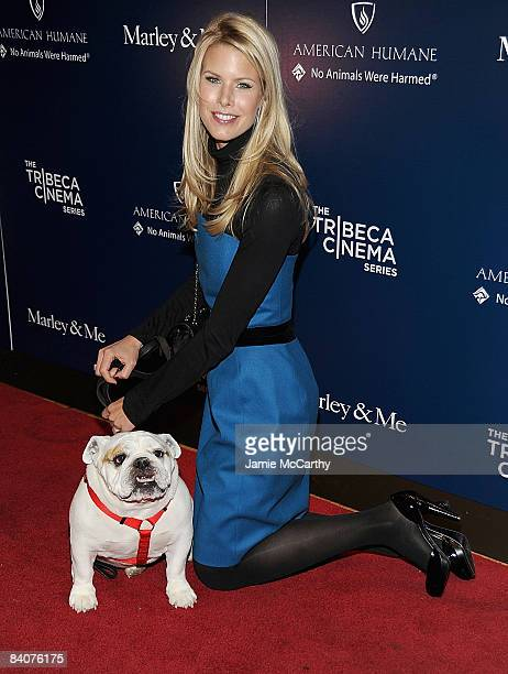 """Beth Ostrosky Stern and her dog Bianca attends the premiere of """"Marley & Me"""" at the Tribeca Cinemas Gallery on December 17, 2008 in New York City."""