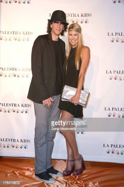 Beth Ostrosky Stern and Howard Stern attend La Palestra Kids Hamptons 2013 at East Hampton Studio on August 3 2013 in Wainscott New York