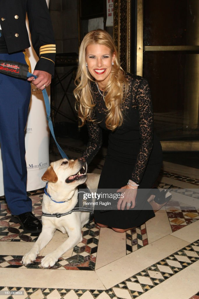 Beth Ostrosky Stern poses for a picture with service dog Oprah during The Animal Medical Center's TOP DOG Gala at Cipriani 42nd Street on December 3, 2012 in New York City.