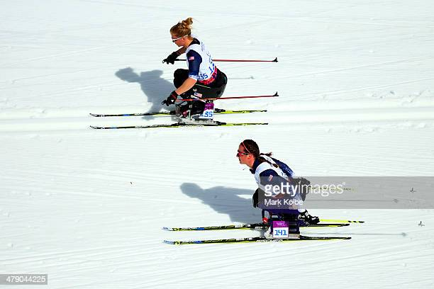 Beth Requist and Tatyana McFadden of the United States compete in the Women's Cross Country 5km Sitting on day nine of the Sochi 2014 Paralympic...
