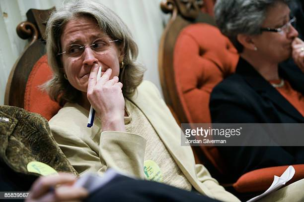 Beth Robinson, of the Vermont Freedom to Marry Task Force, reacts as votes get close enough for a veto override for the same sex Civil Marriage law...