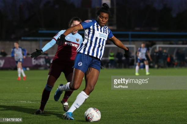 Beth Roe of Brighton and Hove Albion Women in action with Cecillie Kvamme of West Ham United Women chasing her during the Barclays FA Women's Super...