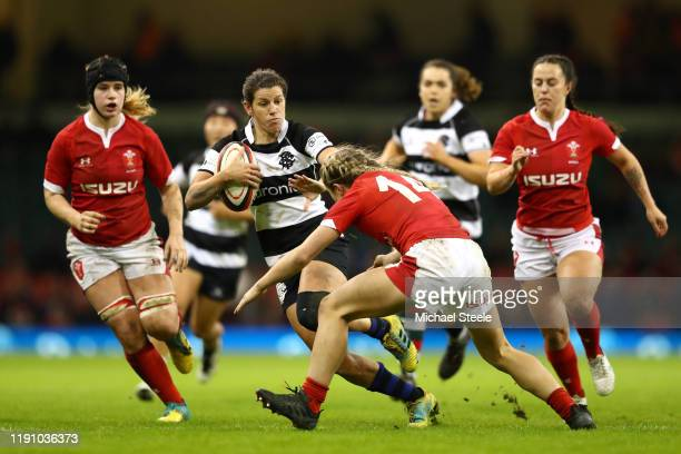 Beth Stafford of Barbarians hands off Paige Randall of Wales during the International Friendly between Wales Women and Barbarians Women at...
