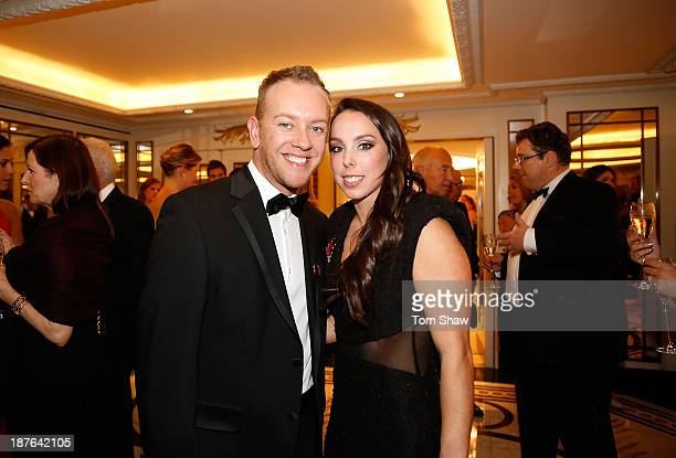 Beth Tweddle of Great Britaian and her partner pose during the British Olympic Ball at The Dorchester on October 30 2013 in London England