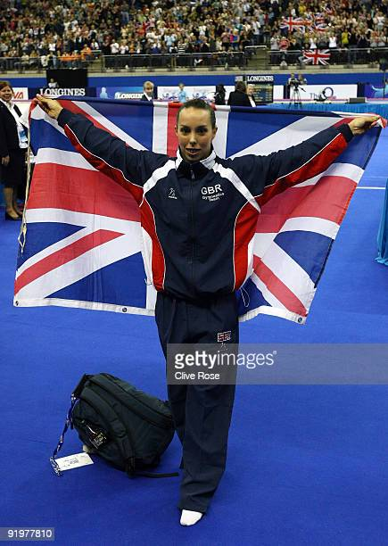 Beth Tweddle of Great Britain celebrates after she won gold in the floor exercise during the Apparatus Finals on the sixth day of the Artistic...
