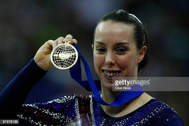 Beth Tweddle of Great Britain celebrates with her gold medal after she won the floor exercise during the Apparatus Finals on the sixth day of the...