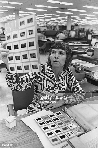 Beth Wray looks through photographic images at Hewlett Packard Boston USA 19th July 1978