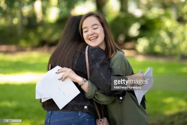 Bethan Thomas hugs a friend on GCSE results day at Ffynone House school on August 20, 2020 in Swansea, Wales. GCSE students were unable to sit their...