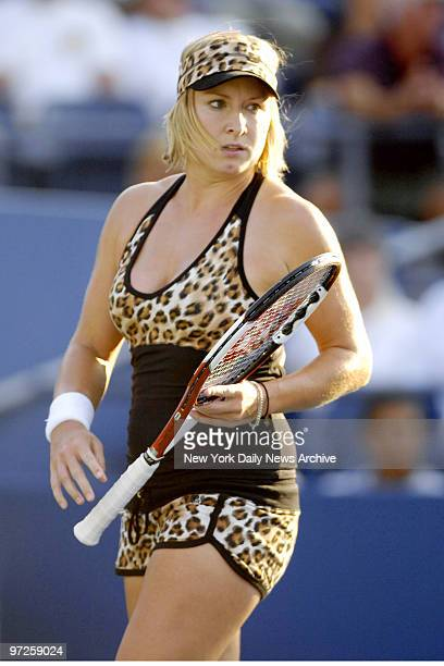 Bethanie Mattek of the United States wears a leopardprint outfit as she plays a doubles match in Louis Armstrong Stadium at the Billie Jean King...