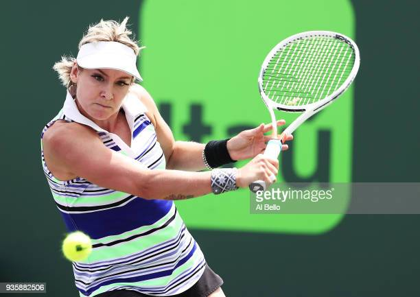 Bethanie Mattek Sands plays a shot against Alize Cornet of France during Day 3 of the Miami Open at the Crandon Park Tennis Center on March 19 2018...