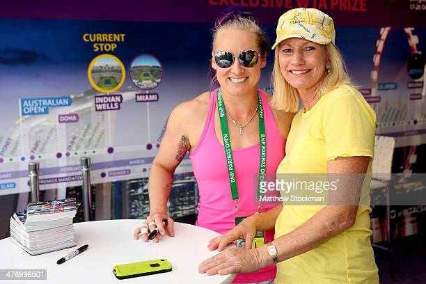 Bethanie Mattek Sands poses for pictures and signs autographs at the WTA booth during the BNP Paribas Open at the Indian Wells Tennis Garden on March...