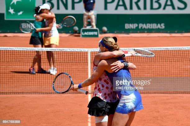 US Bethanie MattekSands and her teammate Czech Republic's Lucie Safarova celebrate in front of Australia's Ashleigh Barty and Australia's Casey...