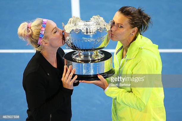 Bethanie Mattek-Sands of the United States and Lucie Safarova of the Czech Republic kiss the trophy after winning their final doubles match against...