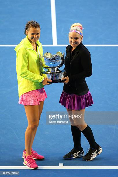 Bethanie Mattek-Sands of the United States and Lucie Safarova of the Czech Republic hold the trophy after winning their final doubles match against...