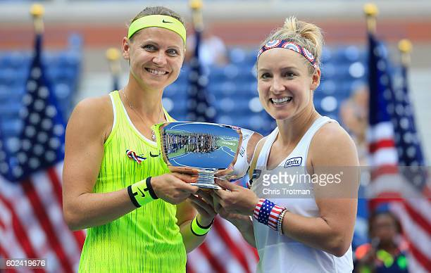 Bethanie Mattek-Sands of the United States and Lucie Safarova of the Czech Republic celebrate with the trophy after defeating Caroline Garcia and...