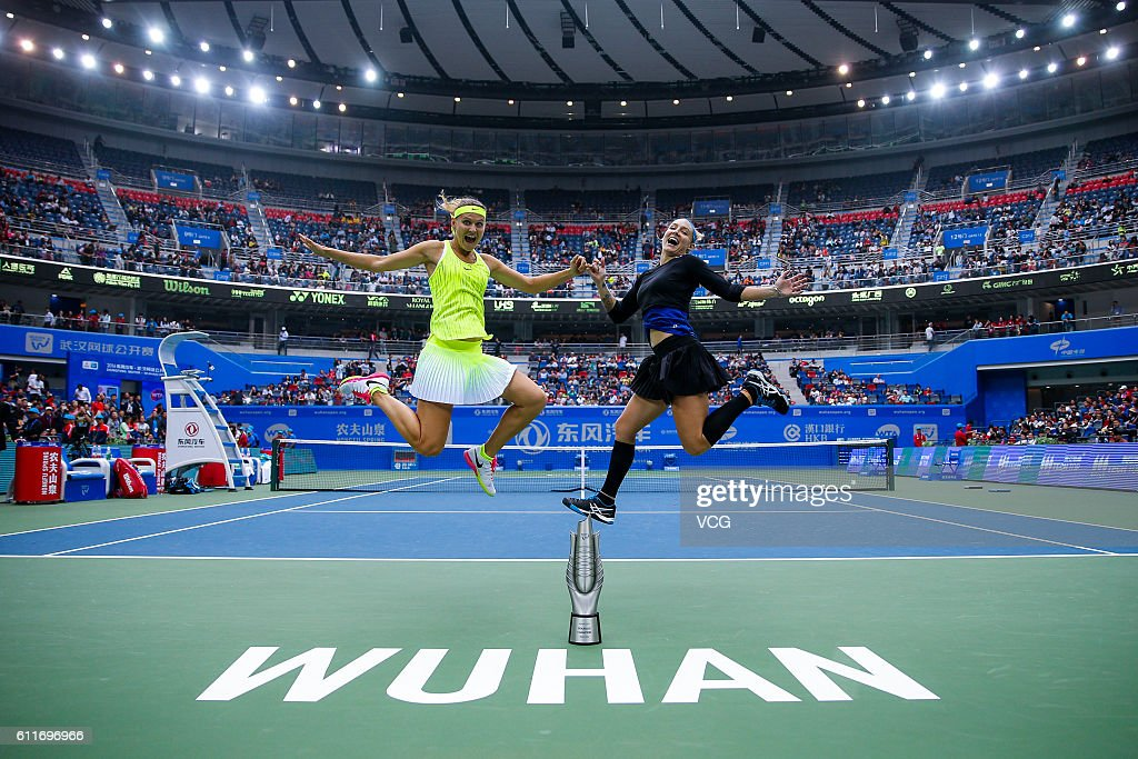 Bethanie Mattek-Sands of the United States and Lucie Safarova of the Czech Republic jump for pictures after winning the women's doubles final match against Barbora Strycova of the Czech Republic and Sania Mirza of India on day seven of the 2016 WTA Dongfeng Motor Wuhan Open at Optics Valley International Tennis Center on October 1, 2016 in Wuhan, Hubei Province of China.
