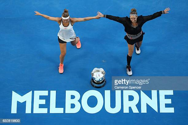 Bethanie MattekSands of the United States and Lucie Safarova of the Czech Republic perform a dance around the championship trophy after winning their...