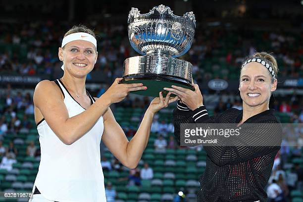 Bethanie MattekSands of the United States and Lucie Safarova of the Czech Republic pose with the trophy after winning their Women's Doubles Final...