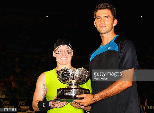 Bethanie MattekSands of the United States of America and Horia Tecau of Romania pose with the winners trophy after defeating Elena Vesnina of Russia...