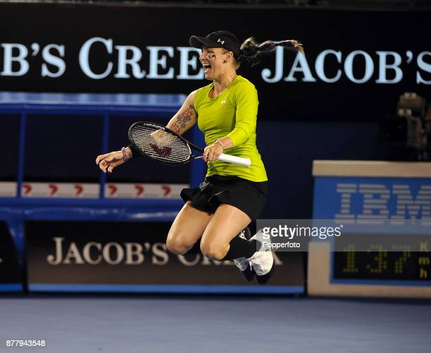 Bethanie MattekSands of the United States of America jumps for joy as she and Horia Tecau of Romania celebrate after defeating Elena Vesnina of...