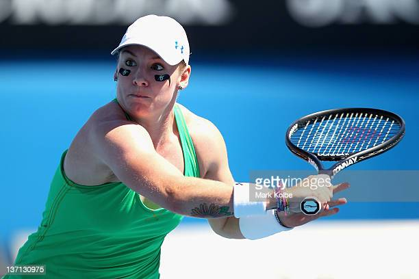 Bethanie MattekSands of the United States of America plays a backhand in her first round match against Agnieszka Radwanska of Poland during day one...