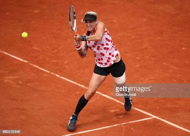 Bethanie MattekSands of The United States plays a backhand during the ladies singles second round match against Petra Kvitova of The Czech Republic...