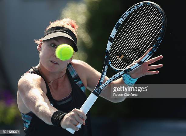 Bethanie MattekSands of the United States plays a backhand in the women's single's match against Eugenie Bouchard of Canada during day two of the...