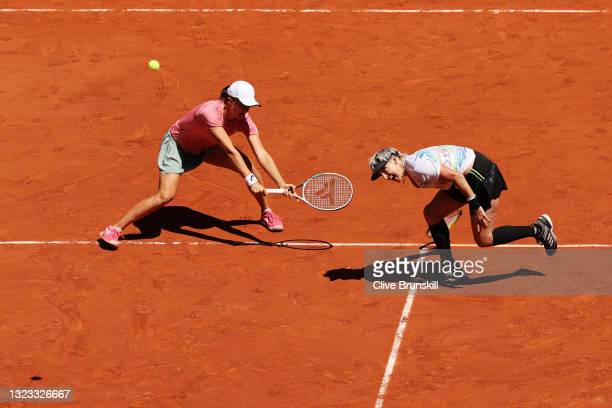 Bethanie Mattek-Sands of The United States, pplayng partner of Iga Swiatek of Poland stretches to play a forehand in their Women's Doubles Final...