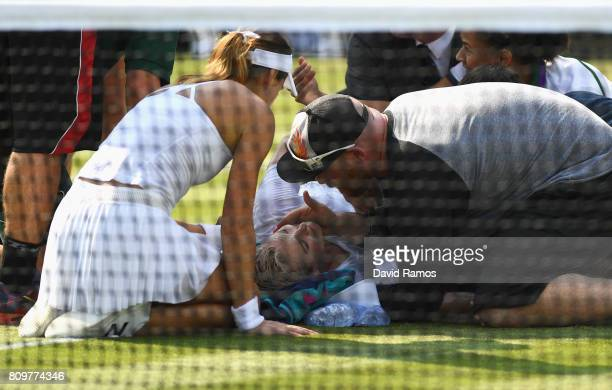 Bethanie Mattek-Sands of The United States receives treatment from the medical team and later retires from the Ladies Singles second round match...