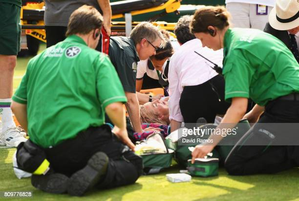 Bethanie MattekSands of The United States receives treatment from the medical team and later retires from the Ladies Singles second round match...