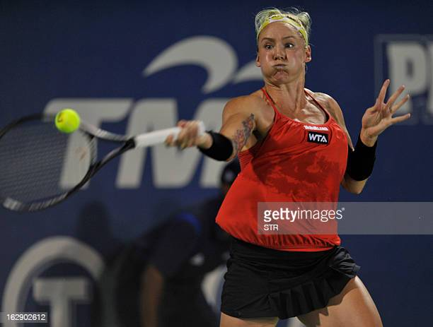 Bethanie Mattek-Sands of the US hits a returns against Taiwan's Su-Wei Hsieh during their women's quarter-final singles match at the BMW Malaysian...
