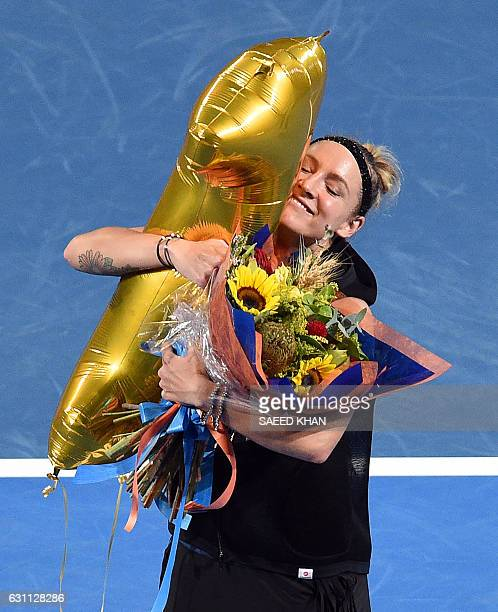 Bethanie Mattek-Sands of the US holds a balloon signifying her world number one ranking in doubles at a presentation after the women's doubles final...