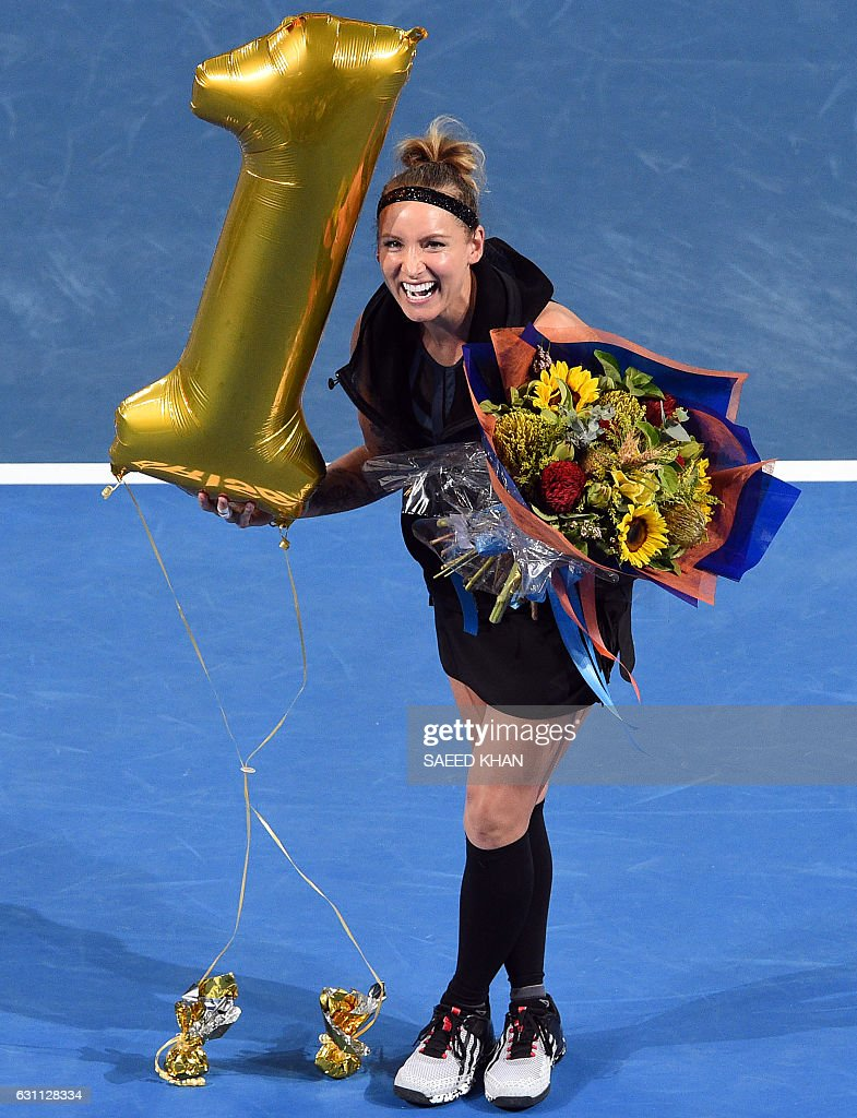 Bethanie Mattek-Sands of the US holds a balloon signifying her world number one ranking in doubles at a presentation after the women's doubles final match at the Brisbane International tennis tournament in Brisbane on January 7, 2017. / AFP / Saeed KHAN / IMAGE