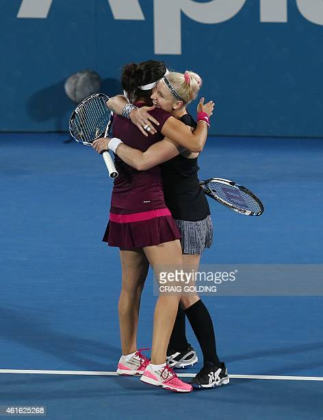 Bethanie Mattek-Sands of the USA and Sania Mirza of India celebrate after winning the women's doubles final against Raquel Kops-Jones of the USA and...