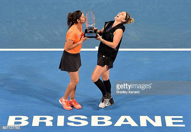 Bethanie MattekSands of the USA and Sania Mirza of India celebrate victory after their match against Ekaterina Makarova of Russia Elena Vesnina of...
