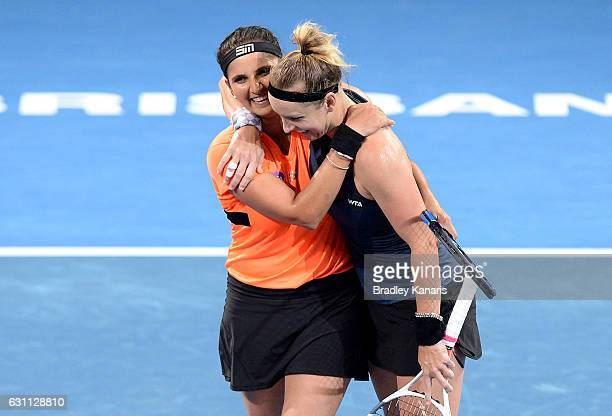 Bethanie MattekSands of the USA and Sania Mirza of India celebrate victory after their match against Ekaterina Makarova and Elena Vesnina of Russia...