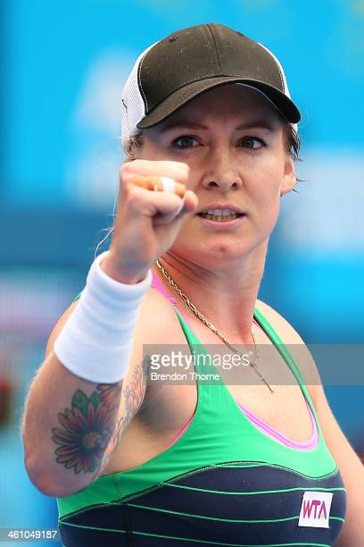 Bethanie MattekSands of the USA celebrates victory in her second round match against Agnieszka Radwanska of Poland during day three of the 2014...