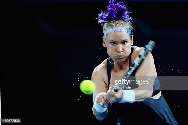 Bethanie Mattek-Sands of the USA plays a backhand during day one of the 2014 Brisbane International at Queensland Tennis Centre on December 29, 2013...