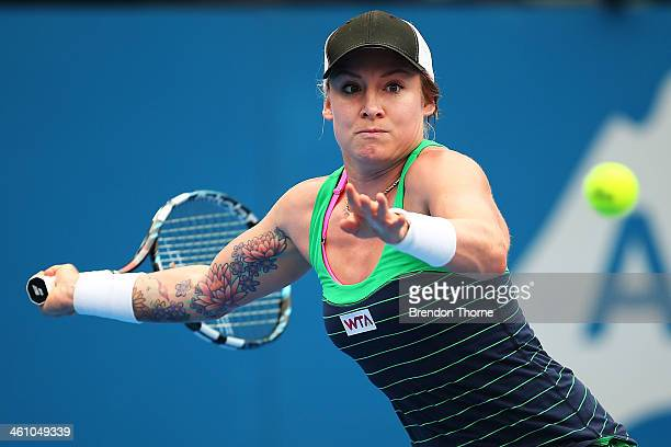 Bethanie MattekSands of the USA plays a forehand in her second round match against Agnieszka Radwanska of Poland during day three of the 2014 Sydney...