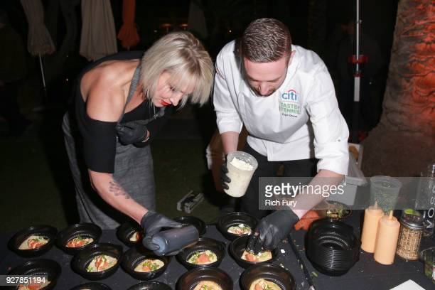 Bethanie MattekSands visits Chef Engin Onural's station during the Citi Taste of Tennis at Hyatt Regency Indian Wells Resort Spa on March 5 2018 in...