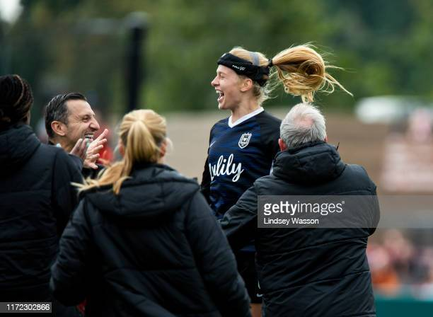 Bethany Balcer of Reign FC celebrates her goal with the bench including head coach Vlatko Andonovski in the second half of the game at Cheney Stadium...
