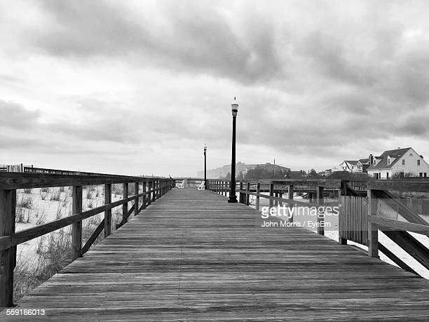 bethany beach boardwalk against cloudy sky - bethany beach stock photos and pictures