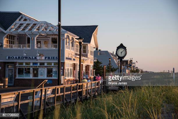 bethany beach boardwalk at sunrise - bethany beach stock photos and pictures