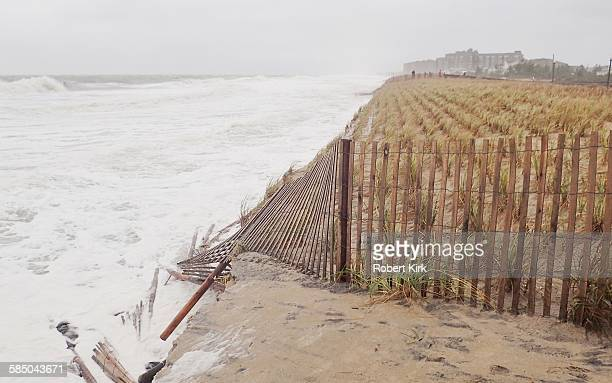 Strong storm causing damage along the Atlantic coast Beach is gone with waves eroding the dune protecting the town View faces south