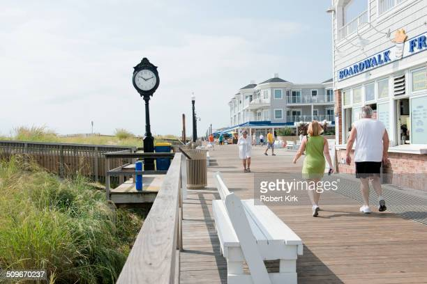 Bethany Beach Delaware USA August 21 2014 Beach visitors enjoying walks on the boardwalk in late August
