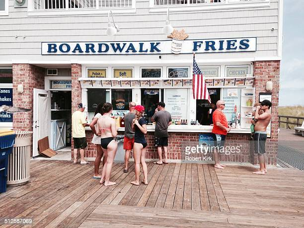 Bethany Beach DelawareUSA August 22 2014 People ordering food at a stand on the boardwalk in Bethany Beach