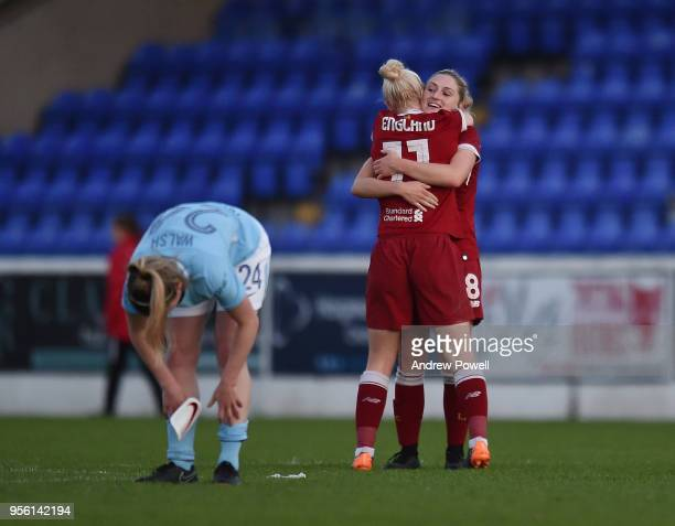 Bethany England and Laura Coombs of Liverpool Ladies embrace after winning the Women's Super League match between Liverpool Ladies and Manchester...