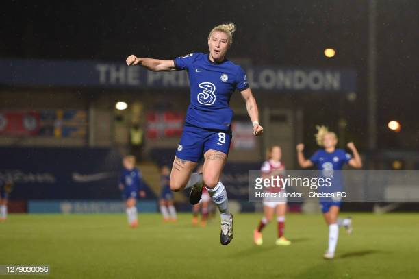 Bethany England of Chelsea celebrates after scoring her team's fourth goal during the FA Women's Continental League Cup match between Chelsea and...