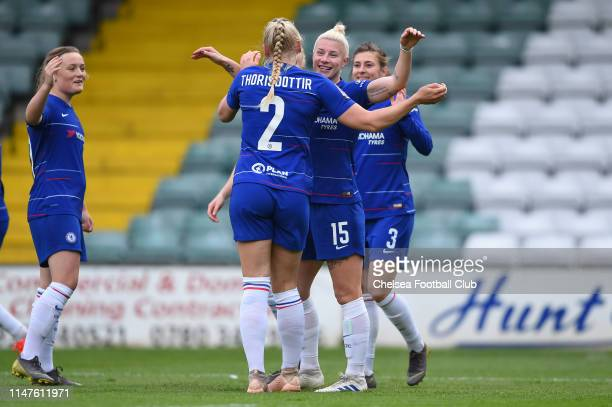 Bethany England of Chelsea celebrates with teammate Maria Thorisdottir after scoring her team's first goal during the WSL match between Yeovil Town...