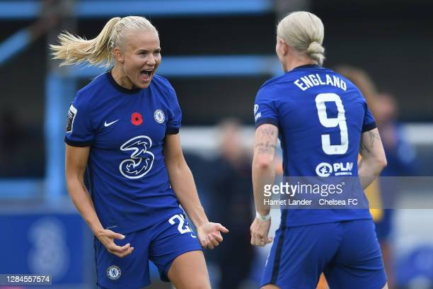 Bethany England of Chelsea celebrates with teammate Pernille Harder after scoring her team's second goal during the Barclays FA Women's Super League...